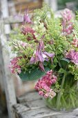 Glass vase of pink lupins