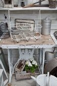 Sewing machine frame repurposed as table in garden shed
