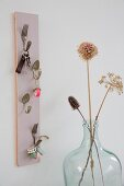 Key hanger hand-crafted from bent vintage cutlery and pastel wooden panel