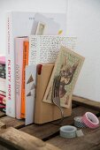 Bookend hand-made from bent vintage fork, various books and washi tape on wooden shelf