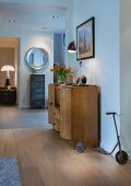 Art-Deco cabinet, filing cabinet and old child's scooter in hallway
