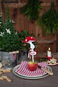 Festively set table with DIY felt toadstool