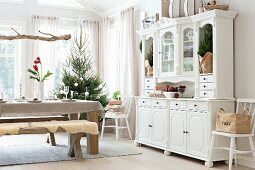 Table set for Christmas, bench and country-house-style dresser