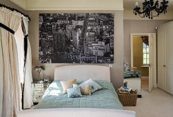 Classic bedroom with large black and white photo mural of New York above bed