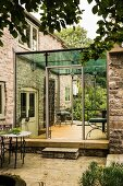 Modern conservatory extension to English, stone, country house