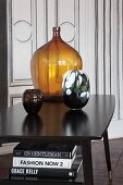 Coloured glass vases on vintage-style black table