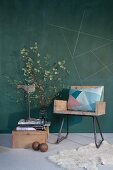 Upcycling - wooden armchair next to sculpture and flowering branch