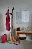 Upcycling - coat stand made from old skis and stacked shoeboxes next to vintage bench