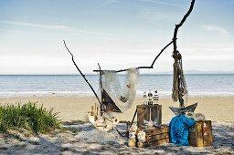 Flotsam artwork on sandy beach