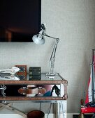 Desk lamp on table made from mirrored suitcase in bedroom