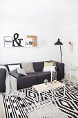 Charcoal-grey couch in modern monochrome living room