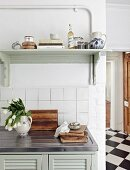 Wooden shelf above sink in country-house kitchen