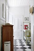 Country-house-style kitchen with chequered floor