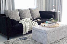 Elegant, black velvet sofa and cord velvet ottoman