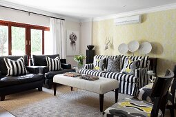 Mixture of striped, ikat and ornamental patterns in black, white and yellow