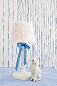 White table lamp with doilies and silk ribbon decorating lampshade