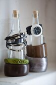 Bracelets and watch on bottles used as jewellery stands