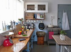 Simple table opposite kitchen counter in rustic kitchen