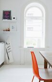 Arched window in bright kitchen of period apartment