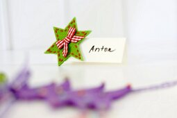 Hand-crafted festive place card decorated with felt star & ribbon