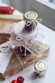 Wrapped gifts and jam jars with hand-written labels