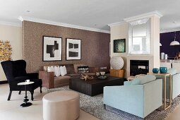 Various upholstered furnishings around wooden coffee table in open-plan living room