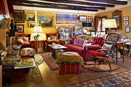 Rustic interior crammed with pictures and rugs
