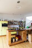 Island counter and yellow cabinet in kitchen