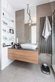 Washstand with large drawers next to shelves in niche