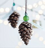 Christmas decorations hand made from pine cones and beads