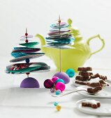 Small, hand-crafted Christmas trees made from paper discs and beads decorating table