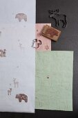 Hand-made festive gift wrap decorated with stamped woodland animal motifs