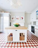 Island counter on red and white chequered floor in spacious kitchen