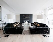 Symmetrical arrangement of sofas and arc lamps in living room