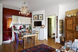 Eclectic kitchen with dining area and artistic chandelier