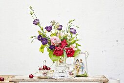 Romantic arrangement with vase of flowers & antique china crockery
