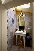 Bathroom with white, vintage, pedestal sink and stone tiles