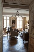Elegant, French-style interior with antique furniture and chandelier
