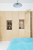 Custom, fitted plywood wardrobe with two open shelf niches for jewellery and other items