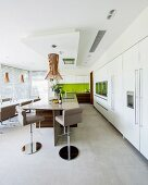 Modern kitchen-dining room with large kitchen counter and bar stools