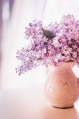Bouquet of lilacs in ceramic jug