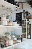 Vintage jars and glass scoops on storage shelves