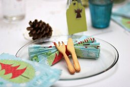 Christmas place setting with folded serviette, place card and pastry cutlery