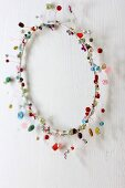 Hand-crafted bead wreath decorating wall