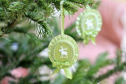 Hand-crafted rosettes with moose motifs and ruffled ribbon; Christmas tree decorations