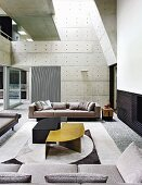 Modern living room with gallery and concrete walls