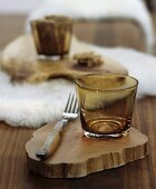 Wooden table set with white sheepskin mat and rustic slices of tree trunk