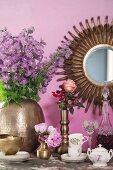 Coffee set, liqueur bottle, glass and romantic bouquet on table
