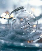 Hand-blown, transparent glass bauble with reindeer figurine inside