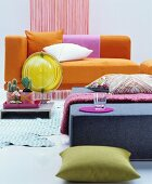 Orange chaise longue and felt ottoman in retro interior